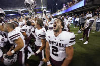 Montana quarterback Cam Humphrey lets out a yell as he celebrates with teammates after they beat Washington in an NCAA college football game Saturday, Sept. 4, 2021, in Seattle. Montana won 13-7. (AP Photo/Elaine Thompson)