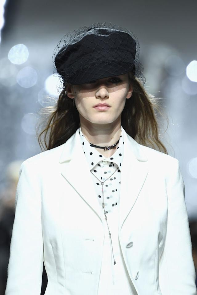 <p>Forget the beret for one moment. The newsboy cap has bobbed up atop the heads of many a street styler this season. And they've even got the catwalk stamp of approval, as models at Dior stepped out in denim baker boy headgear aplenty for SS18. <em>[Photo: Getty]</em> </p>