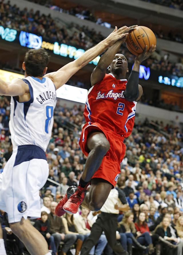 Dallas Mavericks guard Jose Calderon (8) defends as Los Angeles Clippers guard Darren Collison takes a shot during the first half of an NBA basketball game Friday, Jan. 3, 2014, in Dallas. (AP Photo/Sharon Ellman)