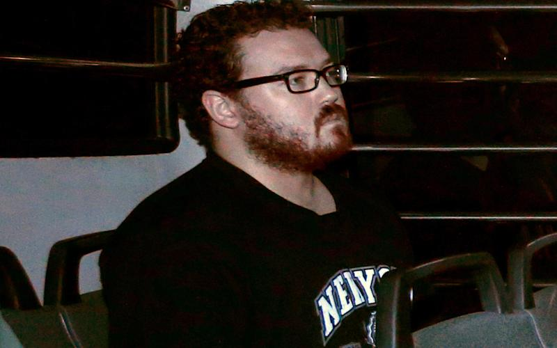 Rurik Jutting in the back row of a prison bus as he arrives at the Eastern Law Courts in Hong Kong November 24, 2014 - REUTERS