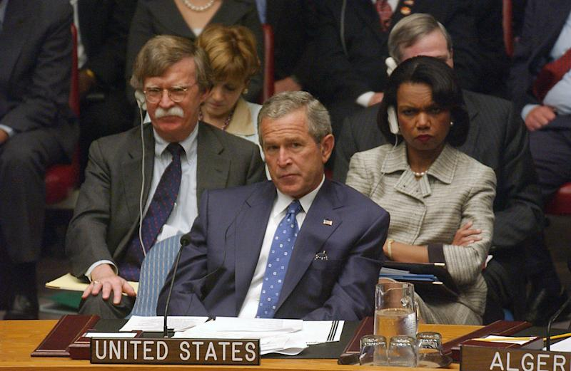 President George W. Bush, Secretary of State Condolezza Rice and U.S. Ambassador to the United Nations John Bolton listen to a Security Council meeting Wednesday, September 14, 2005, in New York. (Photo: Ramin Talaie/Bloomberg News via Getty Images)