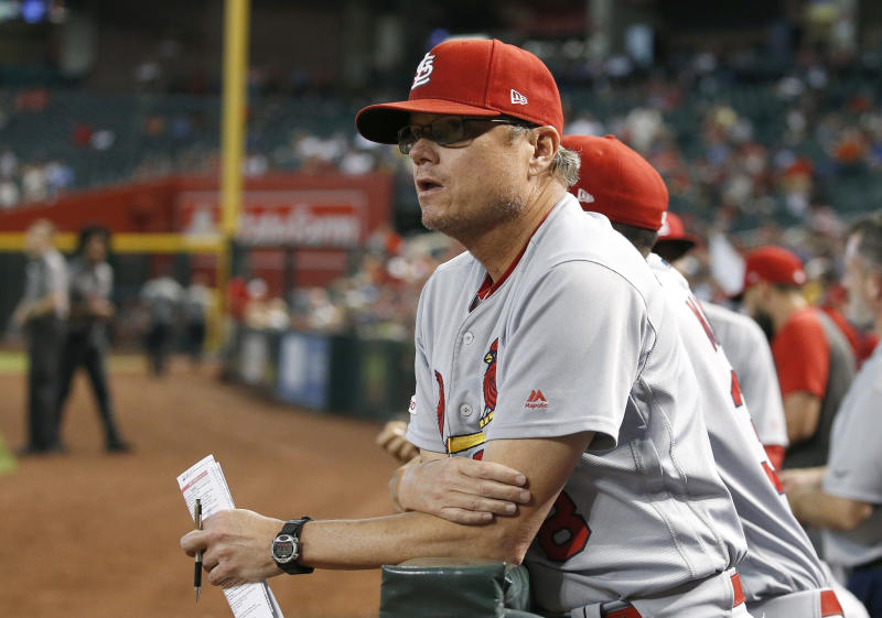FILE - In this Sept. 25, 2019, file photo, St. Louis Cardinals manager Mike Shildt pauses in the dugout during the fifth inning of the team's baseball game against the Arizona Diamondbacks in Phoenix. Shildt has edged out Craig Counsell of the Milwaukee Brewers to win NL Manager of the Year. (AP Photo/Ross D. Franklin, File)