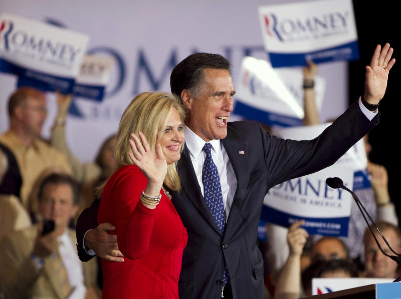 Republican presidential candidate, former Massachusetts Gov. Mitt Romney, right, and his wife Ann wave to a crowd in Schaumburg, Ill., after Romney won the Illinois Republican presidential primary, Tuesday, March 20, 2012.  (AP Photo/Steven Senne)