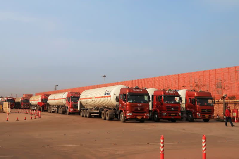 FILE PHOTO: Gas trailers line up for filling liquefied natural gas at Caofeidian terminal, in Tangshan