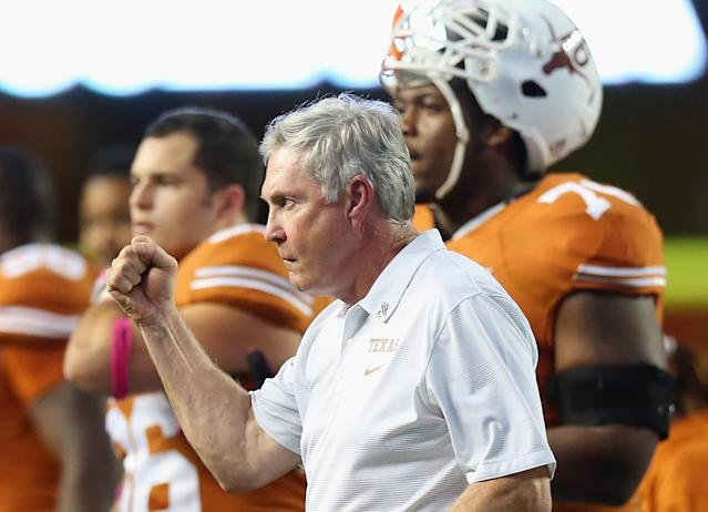 AUSTIN, TX - SEPTEMBER 21: Head coach Mack Brown pumps his fist after a call was overturned during play against the Kansas State Wildcats at Darrell K Royal-Texas Memorial Stadium on September 21, 2013 in Austin, Texas. (Photo by Ronald Martinez/Getty Images)