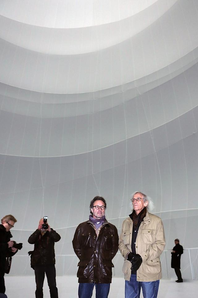 OBERHAUSEN, GERMANY - MARCH 15:  Bulgarian-born artist Christo (R), known for his large-scale environmental art, and his photographer Wolfgang Volz lead journalists through his Big Air Package, his latest work in a former gas storage facility called the Gasometer on March 15, 2013 in Oberhausen, Germany. The piece is made from 5.3 tons of translucent material covering 20,350 square meters and shaped with 4.500 meters of cable, and fills the interior of the facility. The installation will be open to the public from March 16 through December 30. (Photo by Hannelore Foerster/Getty Images)