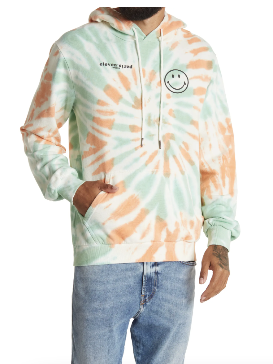green orange and white ElevenParis Smiley Tie Dye Pullover Hoodie and jeans