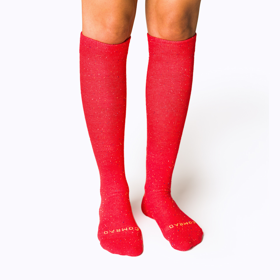 """<h2>Comrad Companion Compression Socks</h2><br>Comrad is an eco-conscious brand of compression socks that helps keep the blood flowing while reducing discomfort and swelling during flights. This pair is for men and women, and they're as comfy as your most casual attire with the super-sock ability to pass as dressy.<br><br><em>Shop</em> <strong><em><a href=""""https://www.comradsocks.com/"""" rel=""""nofollow noopener"""" target=""""_blank"""" data-ylk=""""slk:Comrad"""" class=""""link rapid-noclick-resp"""">Comrad</a></em></strong><br><br><strong>Comrad</strong> Recycled Cotton Compression Socks, $, available at <a href=""""https://go.skimresources.com/?id=30283X879131&url=https%3A%2F%2Fwww.comradsocks.com%2Fcollections%2Fknee-high-compression-socks%2Fproducts%2Frecycled-cotton-compression-socks"""" rel=""""nofollow noopener"""" target=""""_blank"""" data-ylk=""""slk:Comrad"""" class=""""link rapid-noclick-resp"""">Comrad</a>"""