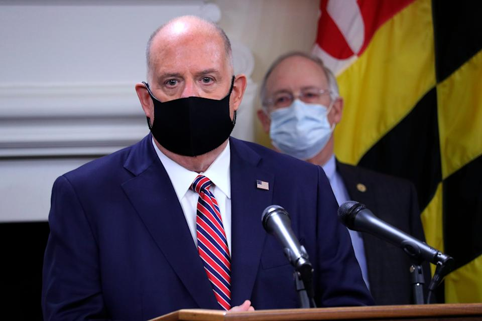 Maryland Gov. Larry Hogan urges people to wear masks to prevent the spread of the coronavirus while speaking at a news conference Nov. 5, 2020, in Annapolis, Maryland.