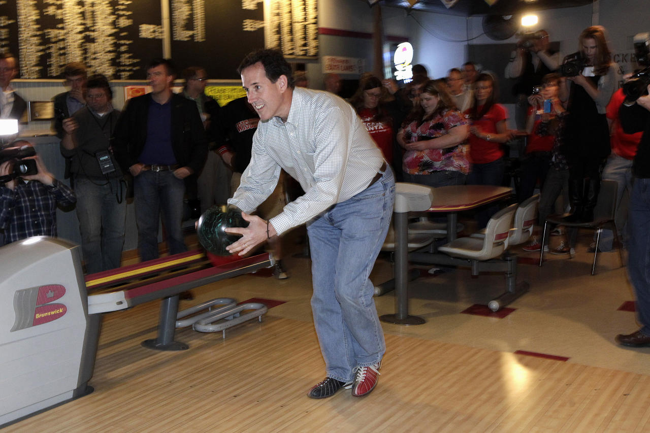 Republican presidential candidate, former Pennsylvania Sen. Rick Santorum bowls in La Crosse, Wis., Wednesday, March 28, 2012. (AP Photo/Jae C. Hong)