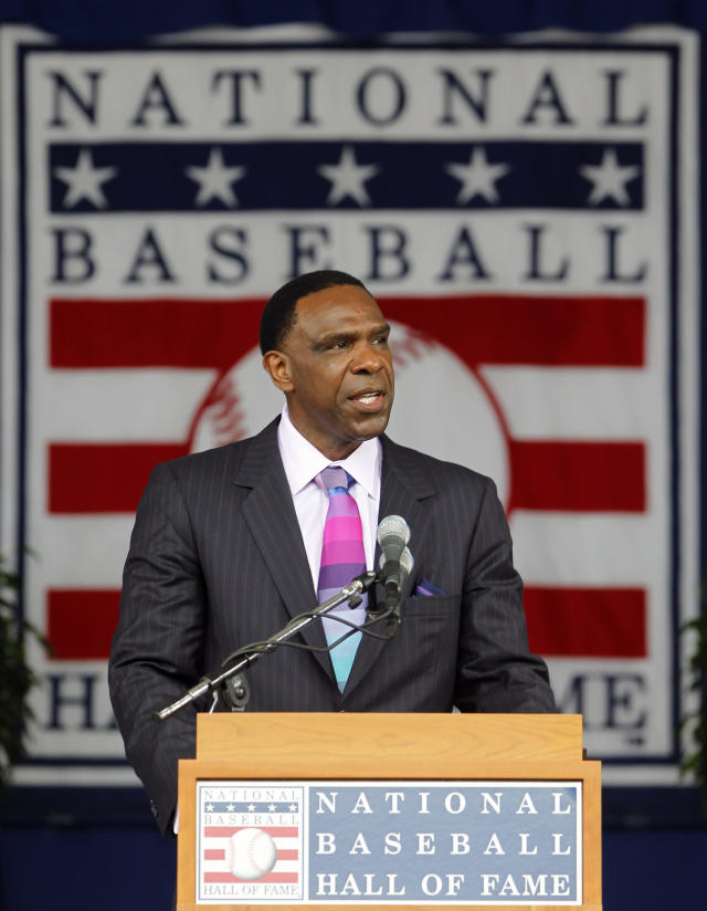 FILE - In this July 25, 2010, file photo, Andre Dawson delivers his Baseball Hall of Fame induction speech during a ceremony at the Clark Sports Center in Cooperstown, N.Y. Dawson was selected in the 11th round of the 1975 baseball draft. (AP Photo/Mike Groll, FIle)