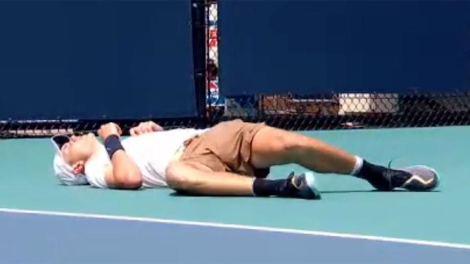 Pictured here, Jack Draper lies on the Miami court after becoming dizzy during his match.
