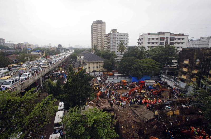 Rescue crews search for survivors at the site of a collapsed residential building in Mumbai