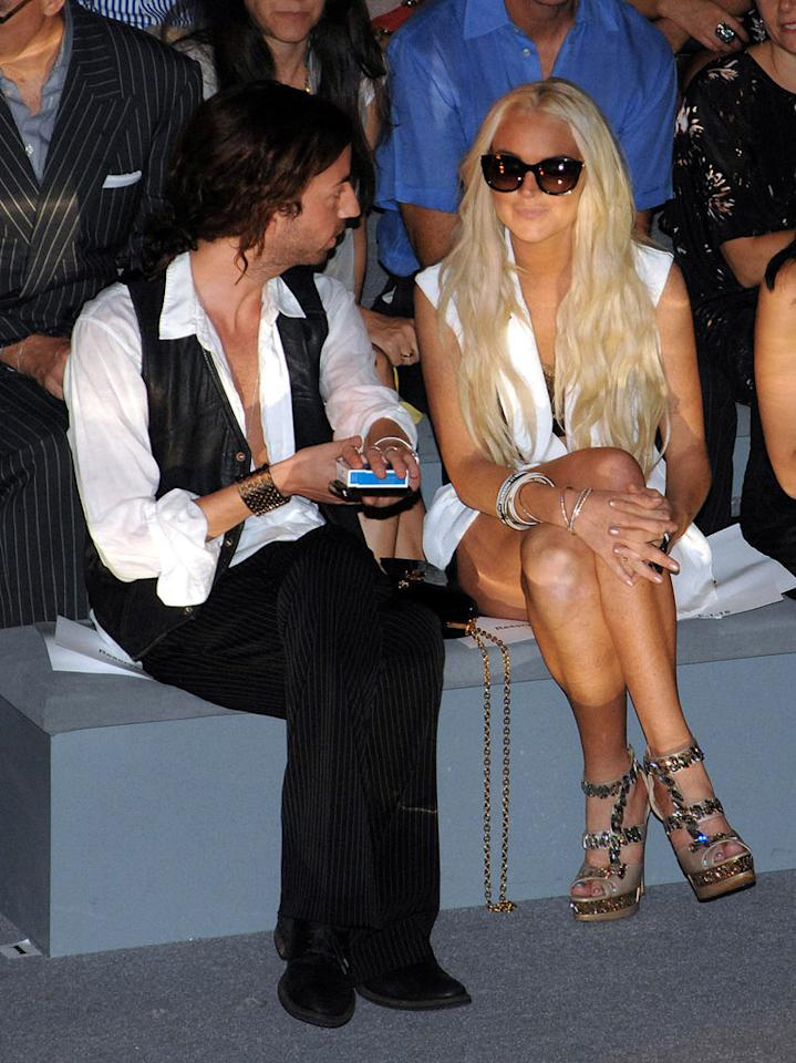 "Lindsay Lohan nearly caused a riot at the Cynthia Rowley show when she arrived wearing a pair of very tiny short shorts. Everyone whipped out their cameras and cellular devices to try to get a shot of the troubled starlet. One photog even broke the ""no walking on the runway"" rule when he hopped up onto the catwalk to get a better look at LiLo. As a result, his camera and his credentials were confiscated. Duffy-Marie Arnoult/<a href=""http://www.wireimage.com"" target=""new"">WireImage.com</a> - September 9 2011"