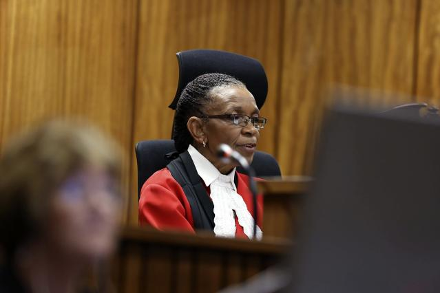 Judge Thokozile Masipa delivers her verdict in the trial of Olympic and Paralympic track star Oscar Pistorius (unseen) at the North Gauteng High Court in Pretoria September 12, 2014. Pistorius was convicted of culpable homicide on Friday, escaping the more serious charge of murder for the killing of his girlfriend, Reeva Steenkamp, and will now battle to avoid going to prison. REUTERS/Alon Skuy/Pool (SOUTH AFRICA - Tags: SPORT ATHLETICS CRIME LAW)