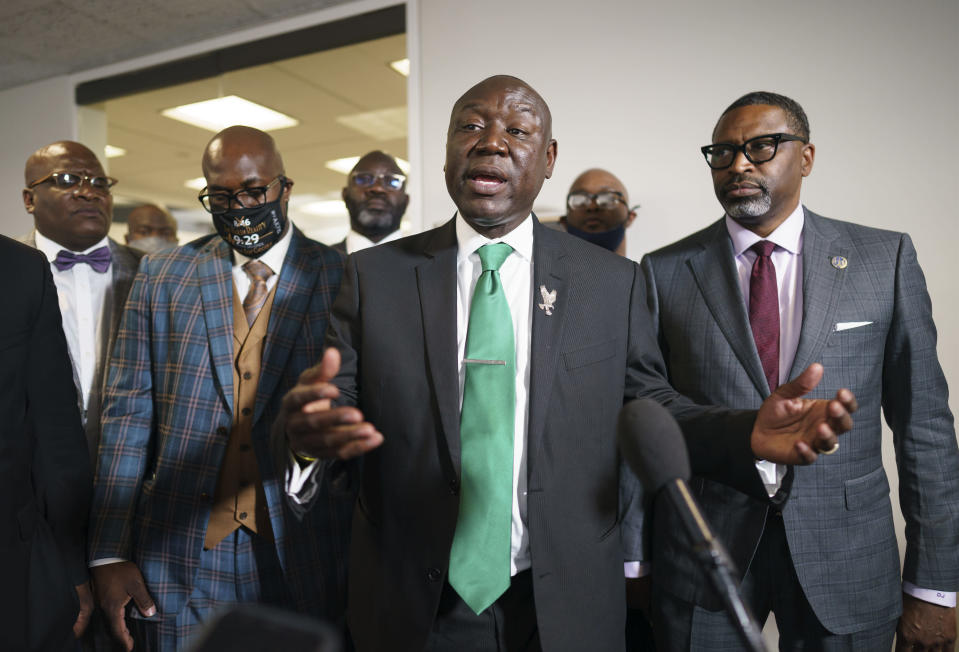Benjamin Crump, center, the civil rights attorney representing the family of George Floyd, joined at right by NAACP President Derrick Johnson, speaks to reporters after they met with Sen. Cory Booker, D-N.J., about police reform legislation, at the Capitol in Washington, Tuesday, May 25, 2021, the first anniversary of Floyd's death at the hands of a white Minneapolis police officer. (AP Photo/J. Scott Applewhite)