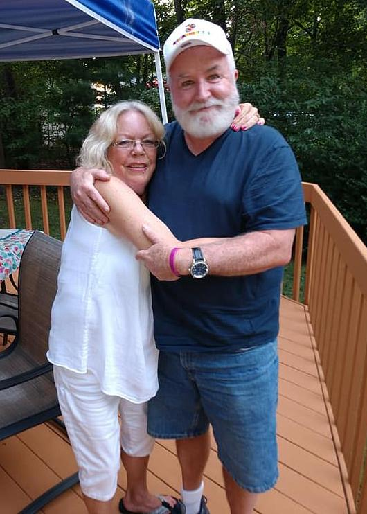 Dwight Powers (R) pictured with an unidentified woman was on a Zoom video call when it is alleged his son murdered him.