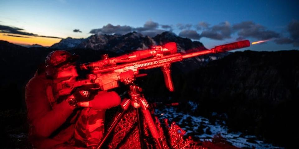 A Belgian Special Forces Sniper engages an elevated target at night during the High Angle Sniper Course, in Hochfilzen training area, Austria