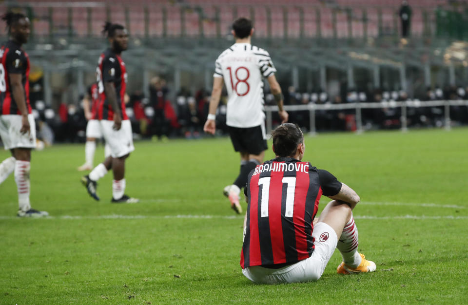 AC Milan's Zlatan Ibrahimovic reacts during the Europa League round of 16 second leg soccer match between AC Milan and Manchester United at the San Siro Stadium, in Milan, Italy, Thursday, March 18, 2021. (AP Photo/Antonio Calanni)