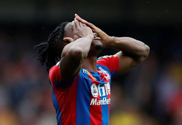 """Soccer Football - Premier League - Watford v Crystal Palace - Vicarage Road, Watford, Britain - April 21, 2018 Crystal Palace's Wilfried Zaha reacts after being shown a yellow card for simulation Action Images via Reuters/Paul Childs EDITORIAL USE ONLY. No use with unauthorized audio, video, data, fixture lists, club/league logos or """"live"""" services. Online in-match use limited to 75 images, no video emulation. No use in betting, games or single club/league/player publications. Please contact your account representative for further details."""