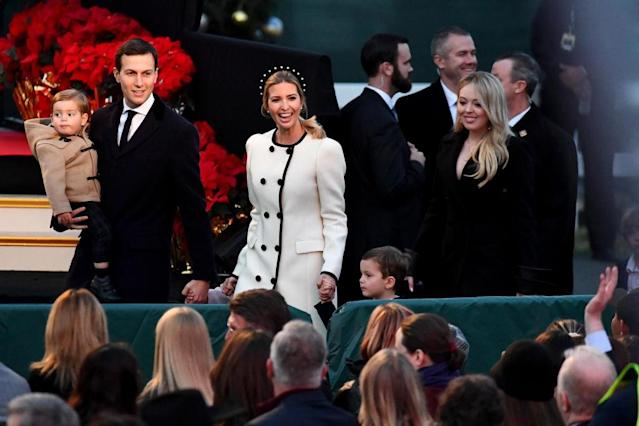 Ivanka Trump arrived to the tree lighting in a white coat with black trim, while Tiffany trailed behind in a black blazer-styled coat. (Photo by Katherine Frey/The Washington Post)
