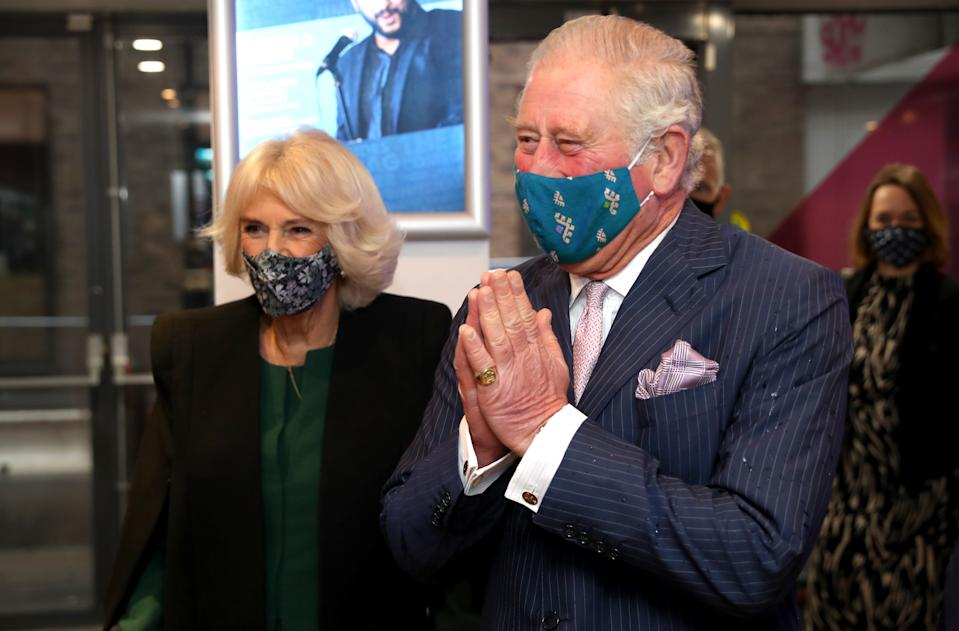 LONDON, ENGLAND - DECEMBER 03: Prince Charles, Prince of Wales uses the traditional namaste greeting as he and Camilla, Duchess of Cornwall visit Soho Theatre to celebrate London's night economy on December 03, 2020 in London, England. (Photo by Chris Jackson - WPA Pool/Getty Images)