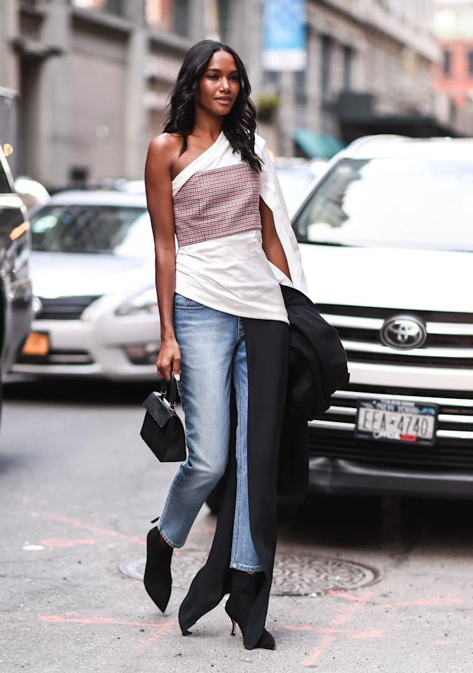 <p>Deconstructed takes on the button-down shirt are still one of our go-tos when we want to master sexy sophistication. We really like this look with mom jeans, pointed-toe stiletto boots, and a structured bag. If it feels warm enough to take off your coat, why not?</p>