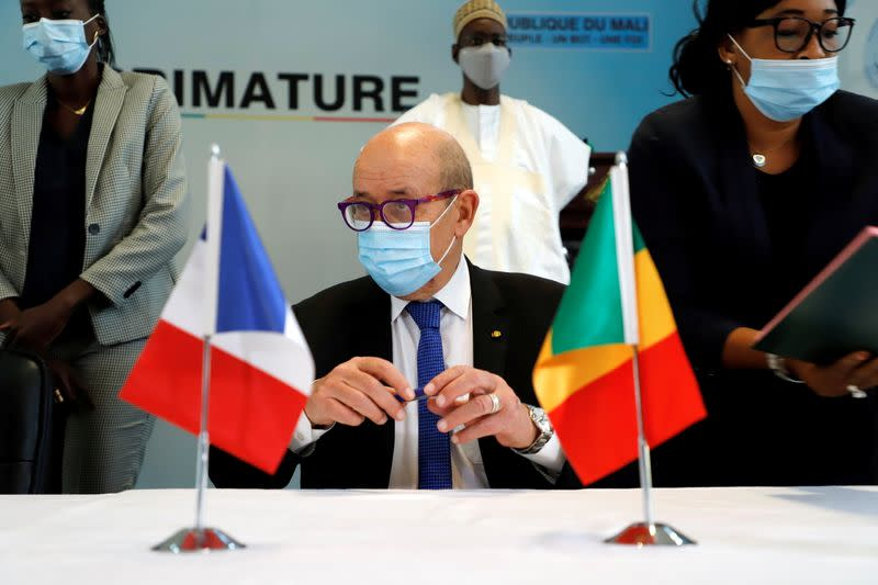 French Foreign Minister Jean Yves Le Drian attends a signing ceremony between France and Mali in Bamako