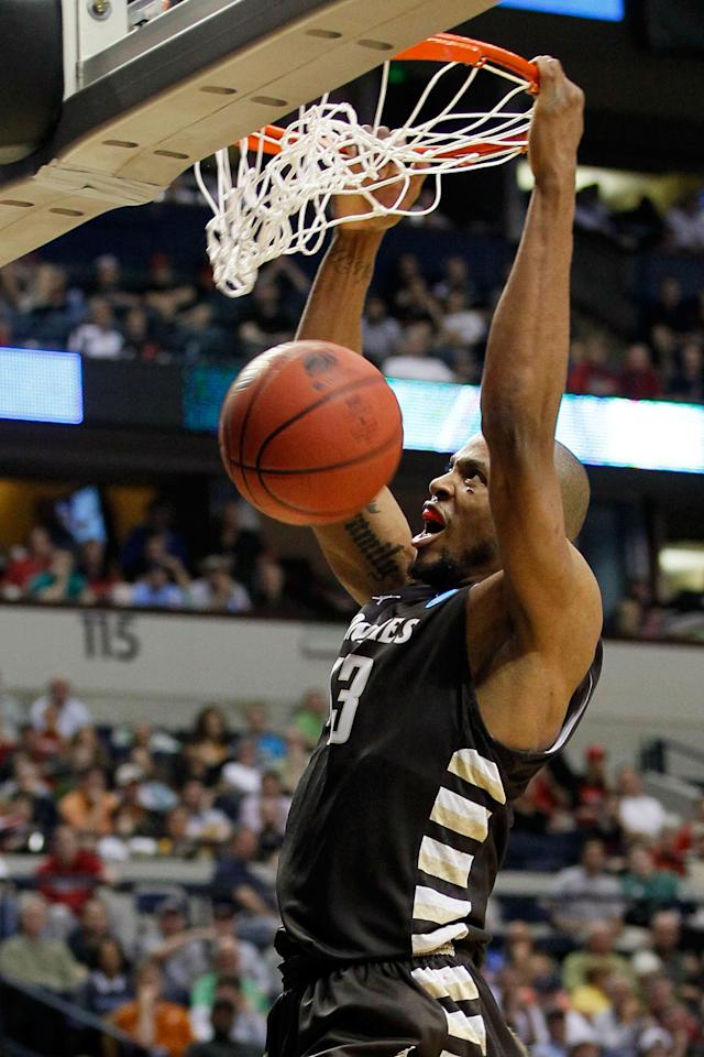 NASHVILLE, TN - MARCH 16: Da'Quan Cook #43 of the St. Bonaventure Bonnies dunks the ball against the Florida State Seminoles during the second round of the 2012 NCAA Men's Basketball Tournament at Bridgestone Arena on March 16, 2012 in Nashville, Tennessee. (Photo by Kevin C. Cox/Getty Images)