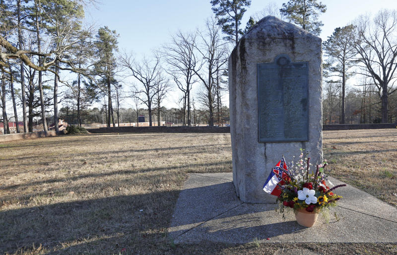 File-This March 5, 2019, file photo shows a memorial marker standing in the University of Mississippi campus cemetery that has the graves of Confederate soldiers killed at the Battle of Shiloh. The University of Mississippi's leader says he agrees that a Confederate monument should be shifted from its current spot on campus. Interim Chancellor Larry Sparks said in a Thursday, March 21, 2019, statement that he is consulting with historic preservation officials on relocating the statue. (AP Photo/Rogelio V. Solis, File)