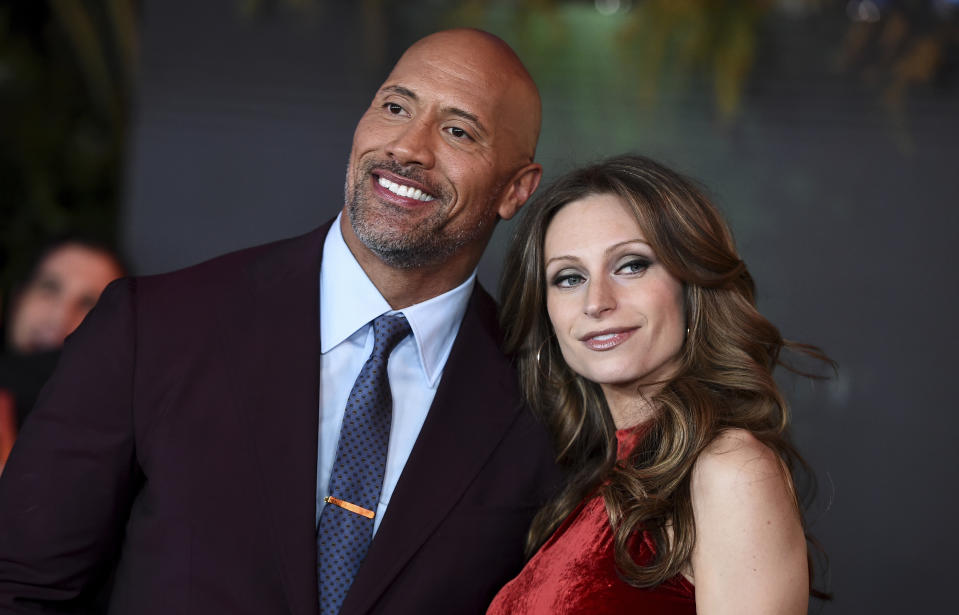 "Lauren Hashian and Dwayne Johnson arrives at the Los Angeles premiere of ""Jumanji: Welcome to the Jungle"" on Monday, Dec. 11, 2017 in Hollywood, Calif. (Photo by Jordan Strauss/Invision/AP)"