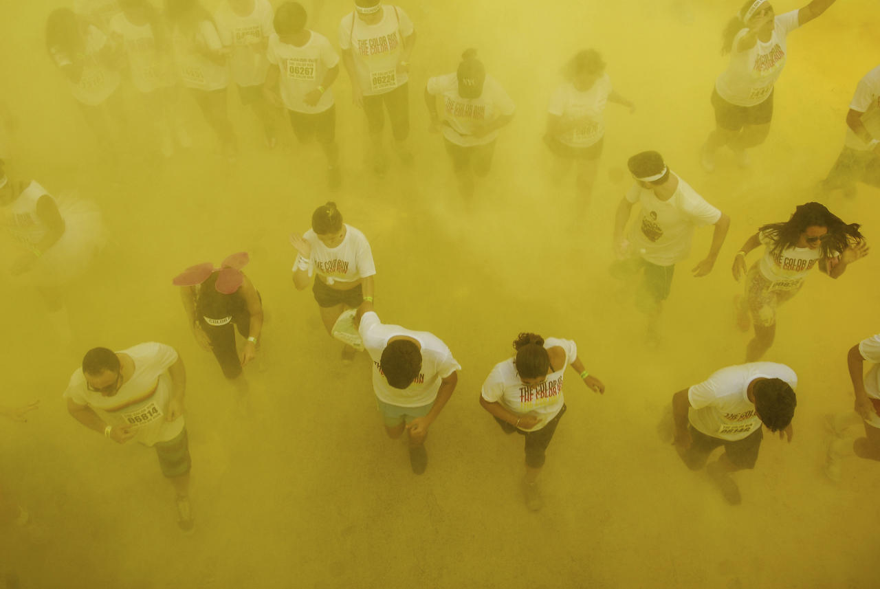 RIO DE JANEIRO, BRAZIL - DECEMBER 16: People run during The Color Run on December 16, 2012 in Rio de Janeiro, Brazil. (Photo by Ronaldo Brandao/NewsFree/LatinContent/Getty Images)