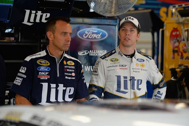 Crew chief Paul Wolfe (L) has already served two races of his three-race suspension.