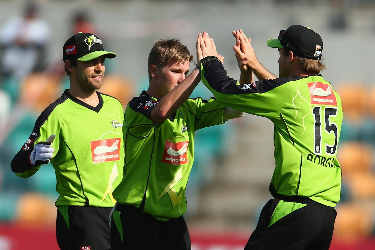 HOBART, AUSTRALIA - DECEMBER 23: Adam Zampa of the Thunder celebrates the wicket of Tim Paine of the Hurricanes with Cameron Borgas during the Big Bash League match between the Hobart Hurricanes and the Sydney Thunder at Blundstone Arena on December 23, 2012 in Hobart, Australia.  (Photo by Robert Cianflone/Getty Images)
