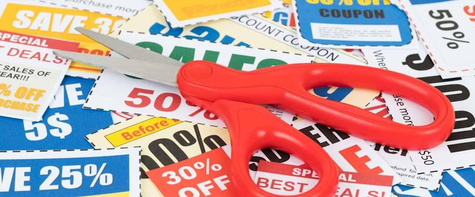 Save discount coupon with scissors, coupons are mock up