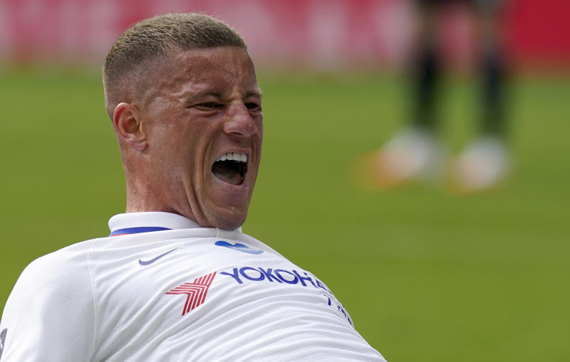 Chelsea's Ross Barkley celebrates after scoring his side's opening goal during the FA Cup sixth round soccer match between Leicester City and Chelsea at the King Power Stadium in Leicester, England, Sunday, June 28, 2020. (Tim Keeton/Pool via AP)