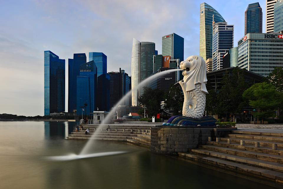 The iconic Merlion statue is seen against the backdrop of Singapore's Central Business District in this 29 January 2020 photo. (PHOTO: Getty Images)