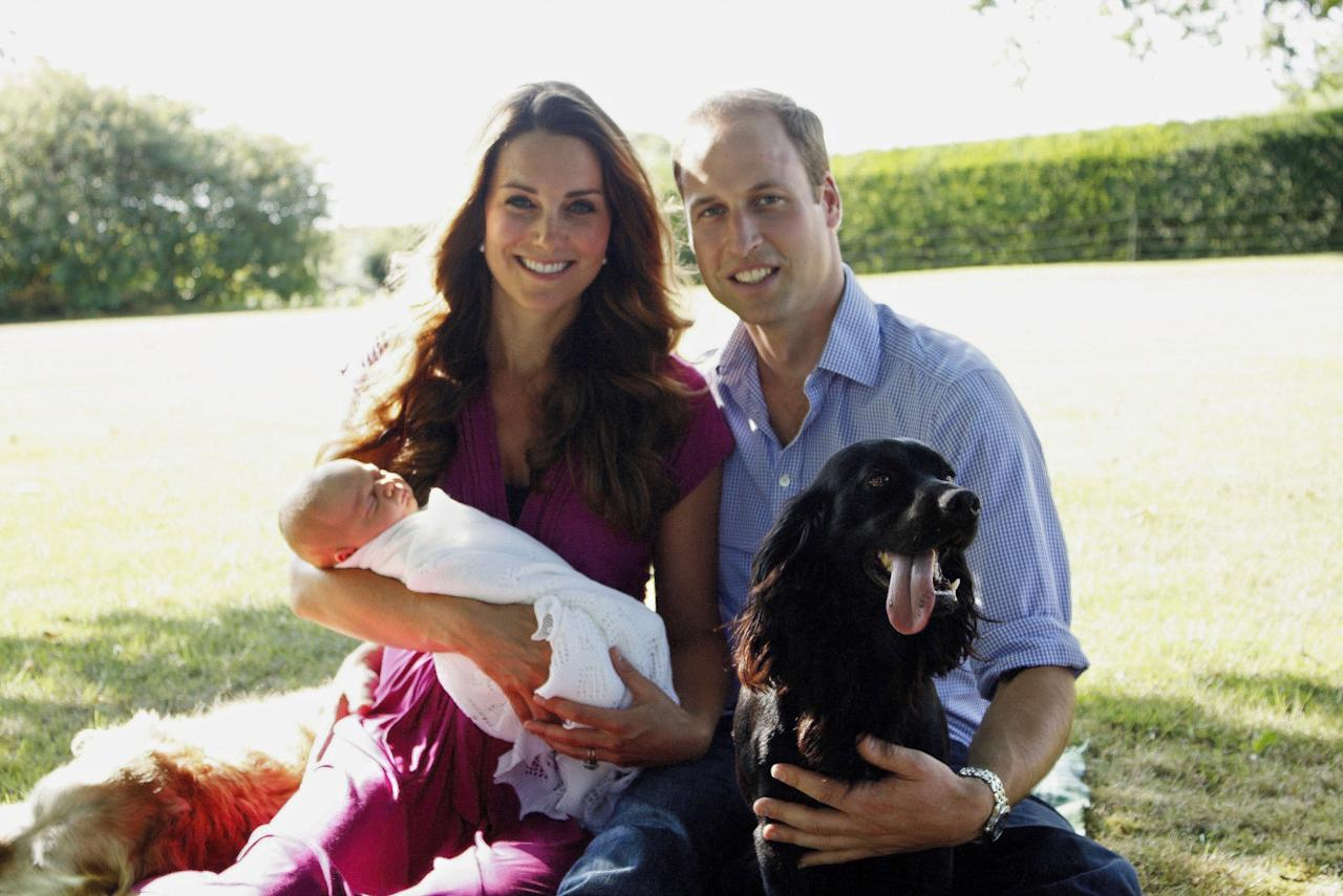 <p><strong>When: August 2013</strong><br />Catherine and Prince William pose for a photograph with their son, Prince George. They are surrounded by Lupo (the couple's cocker spaniel) and Tilly (the retriever) in the garden of the Middleton family home in Bucklebury, Berkshire. <em>(Photo by Michael Middleton – WPA Pool/Getty Images)</em> </p>