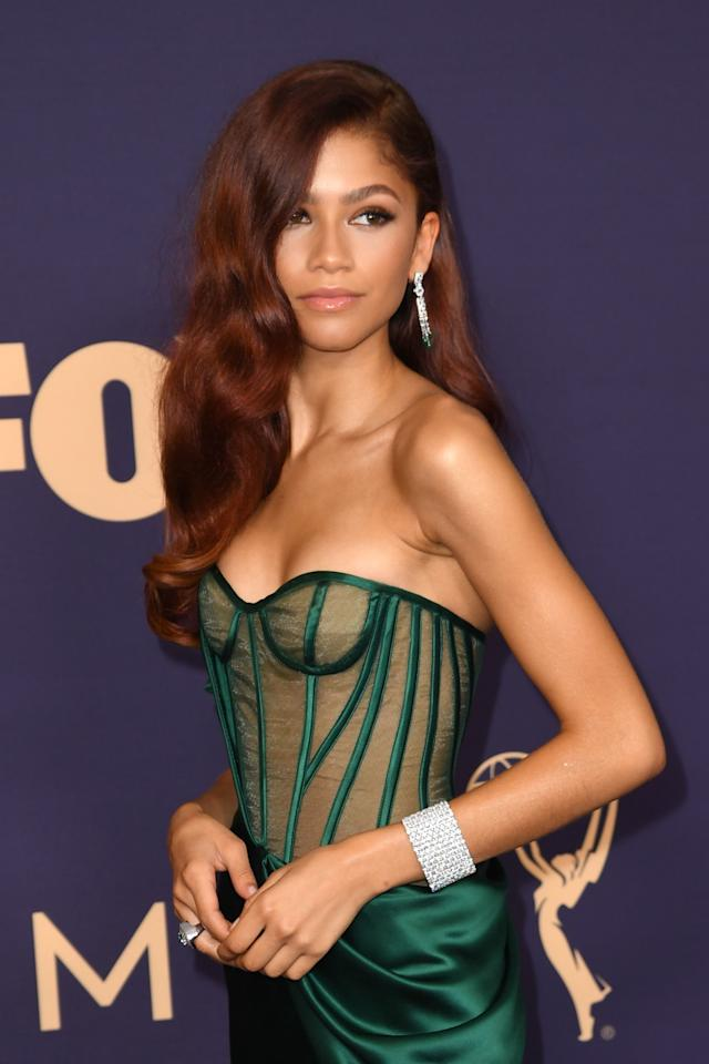 Zendaya took to the Emmys carpet with a soft, retro-glam look, styling her long red-hued locks into loose waves and a side-part. She kept her makeup subtle, sticking with a brown smoky eye and pale pink lip.
