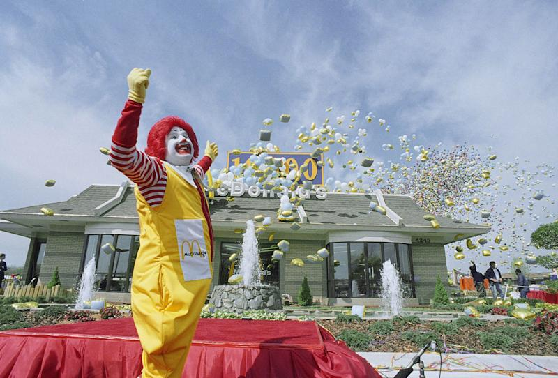 FILE - In this file photo taken April 6, 1988, Ronald McDonald watches as about 20,000 balloons head skyward at the opening of the 10,000th McDonalds restaurant worldwide, in Dale City, Va. Some branding experts think the McDonald's Corp. clowns' floppy red shoes and flaming-red hair are too hackneyed for iPod-savvy kids.  (AP Photo/Dennis Cook, file)