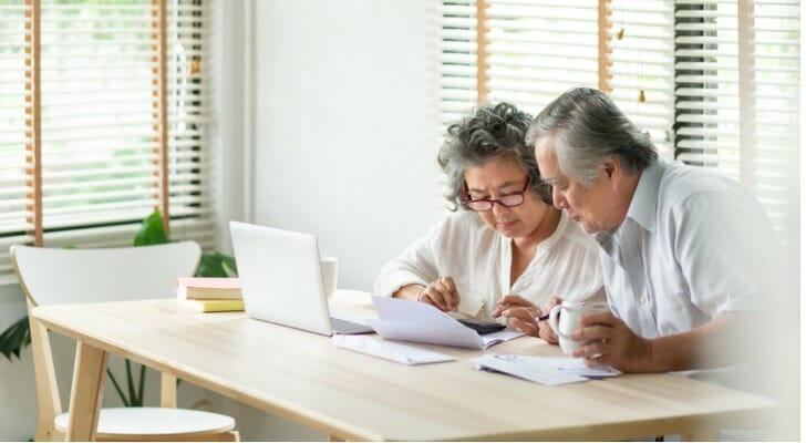 Senior Asian Couples Check Their Investments