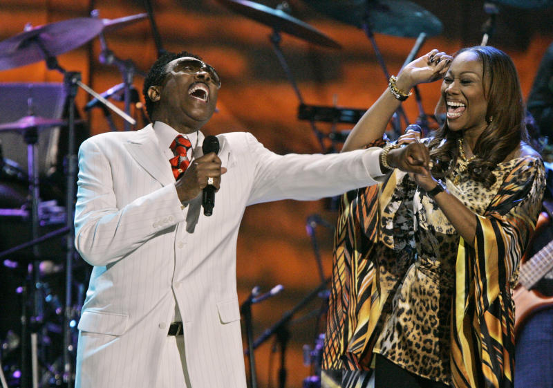 FILE - In this May 23, 2007 file photo, Jessy Dixon, left, performs with Yolanda Adams in Washington.  Dixon, whose extensive travels helped popularize gospel music outside the United States, died Monday, Sept. 26, 2011 at his home in Chicago. He was 73.  (AP Photo/Manuel Balce Ceneta, File)