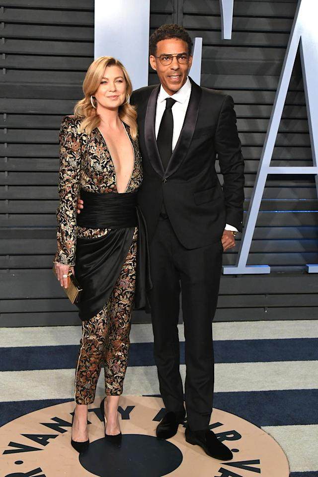<p>Clad in an Azzaro jumpsuit, the <em>Grey's Anatomy</em> star brought her own McDreamy to the <em>Vanity Fair</em> bash: husband Chris Ivery. (Photo: Jon Kopaloff/WireImage) </p>