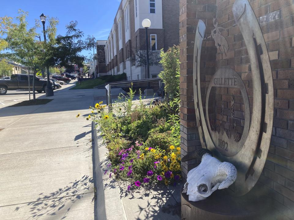 A metal sculpture and flower bed decorate downtown Gillette, Wyo., on Tuesday, Sept. 21, 2021. Wyoming has the lowest COVID-19 vaccination rate in the U.S. and the Gillette area has one of the lowest rates in Wyoming. (AP Photo/Mead Gruver)