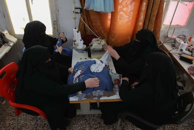 Former regime detainees, including Hasna, now make their living at a sewing workshop in rebel held Idlib province (AFP Photo/Aaref WATAD)
