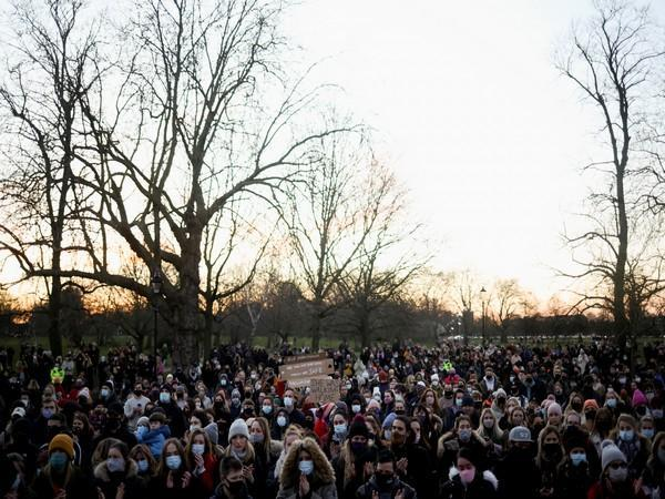 People gather at a memorial site in London following the kidnap and murder of Sarah Everard (Photo credit: Reuters)