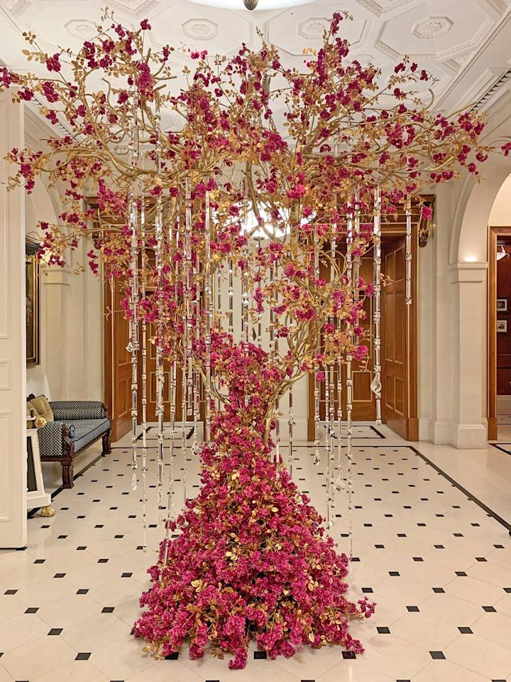 """<p><a href=""""https://www.oetkercollection.com/hotels/the-lanesborough/festive/"""" target=""""_blank"""">The Lanesborough </a>in London unveiled a high-fashion tree for the holiday season, created in collaboration with British fashion house Ralph & Russo and Tony Marklew. The tree was inspired by the intricate detailing seen in Ralph & Russo's recent collection, with chandelier-like crystals and leaf embellishments. Lilibet, the hotel's beloved resident cat, received a bespoke collar as part of the collaboration just for the holiday season.</p><p>""""With couture there's always a thread of magic in every piece, and we're delighted this holiday season to bring that spirit to the hotel and celebrate with all who visit The Lanesborough,"""" Tamara Ralph, the Creative Director of Ralph & Russo, said.</p>"""