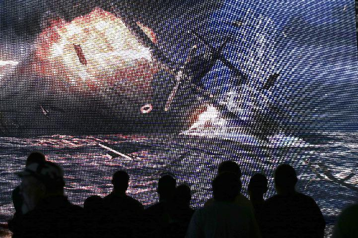 "Show attendees watch a presentation on the video game ""World of Warships"" at the Wargaming.net booth during the Electronic Entertainment Expo in Los Angeles, Wednesday, June 12, 2013. (AP Photo/Jae C. Hong)"