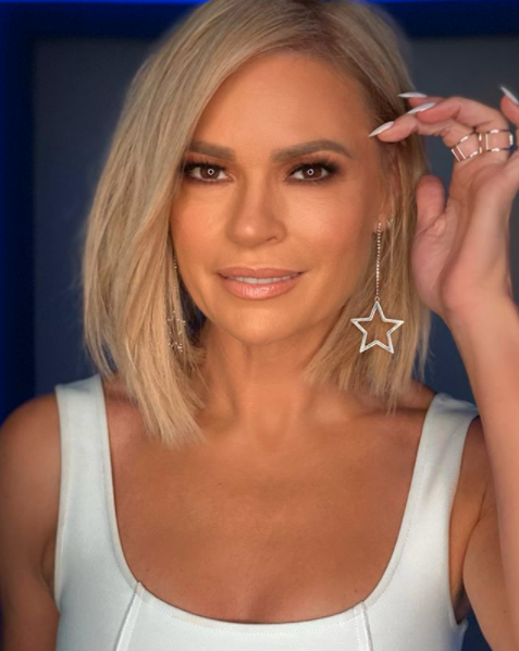 Sonia Kruger in a white top and star earrings.