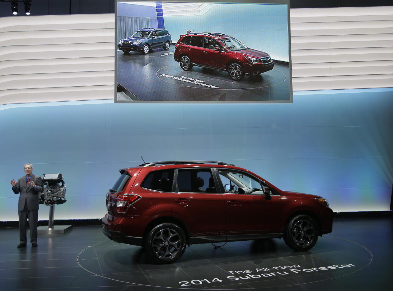 Thomas J. Doll, Executive Vice President, Chief Operating Officer and Chief Financial Officer for Subaru of America, Inc.talks about the 2014 Subaru Forester XT during it's world debut at the LA Auto Show in Los Angeles, Wednesday, Nov. 28, 2012. (AP Photo/Chris Carlson)
